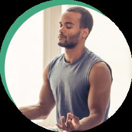 Afro American Man Doing Yoga Stock Photo
